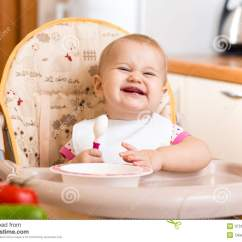 Baby High Chair For Eating 2 Person Bean Bag Funny In On Kitchen Stock Image
