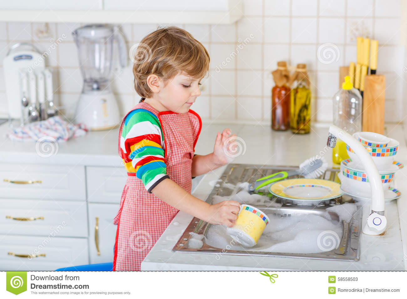 Funny Blond Kid Boy Washing Dishes In Domestic Kitchen Stock Image  Image 58558503