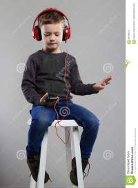 Funny Child.little Boy In Headphones Sitting On Chair ...
