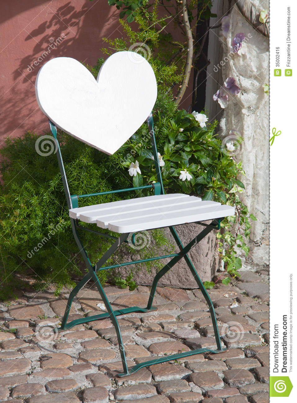 Garden Chair With Heart Shape Backrest On Cobblestone With