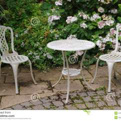 Patio Tables And Chairs Shower Chair With Swivel Seat Garden Table Stock Photo Image Of Paving