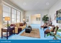 Georgous Living Room With Bright Blue Carpet. Stock Photo ...
