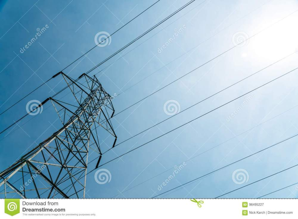 medium resolution of gigantic high voltage electical tower phone tower at angle on sunny day