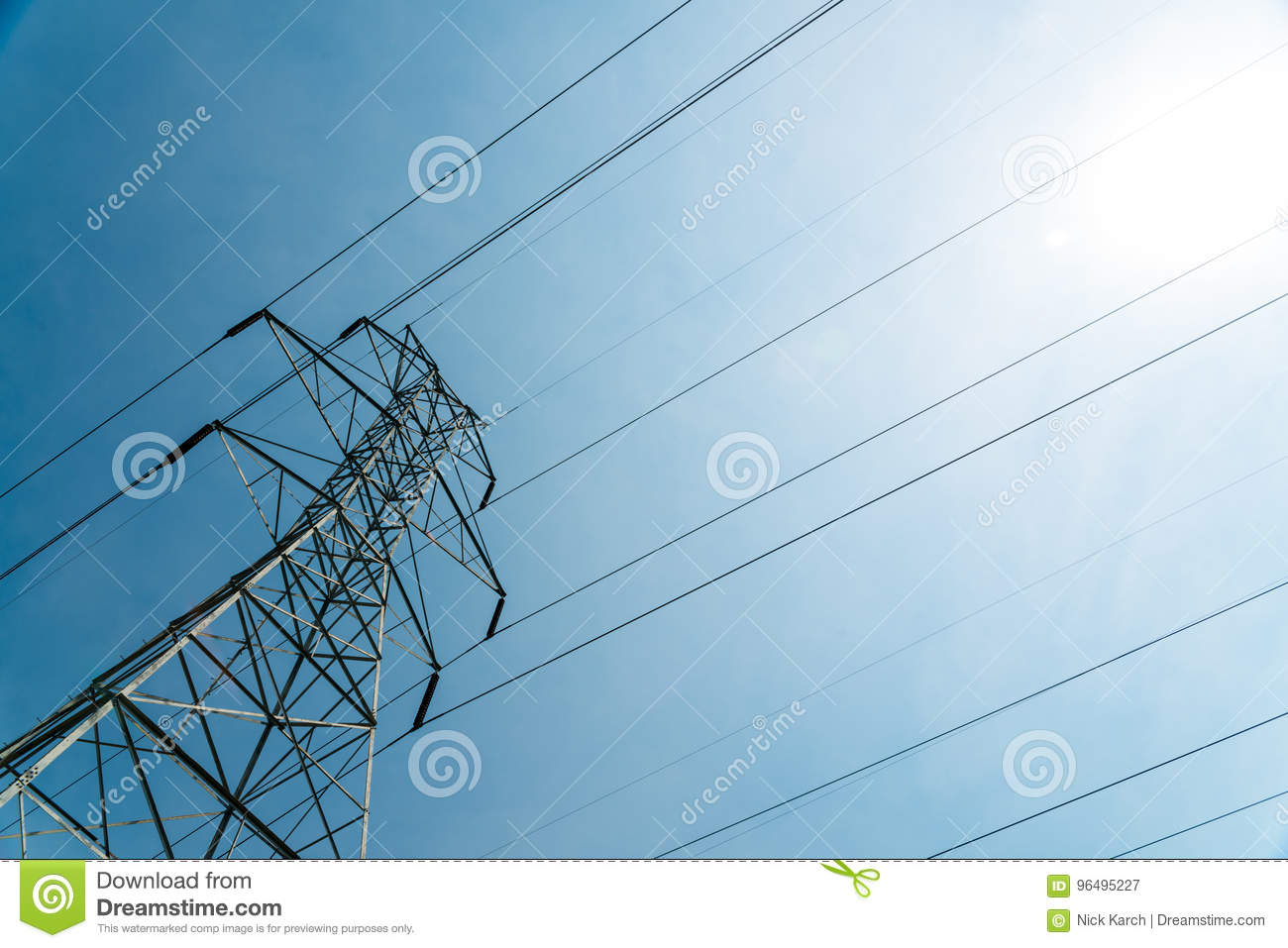 hight resolution of gigantic high voltage electical tower phone tower at angle on sunny day
