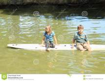 Girl And Boy Playing Surf Stock - 57412272