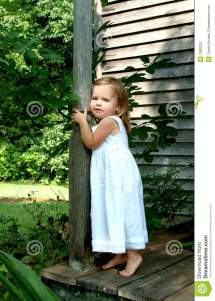 Little Girl Standing On Porch