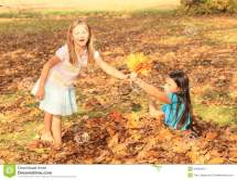 Girl Giving Maple Leaves Stock - 34584214