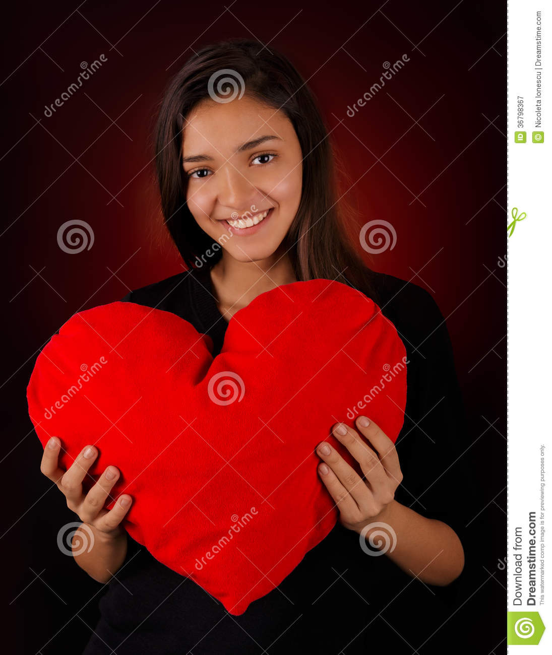 Portrait Of A Pretty Girl Hugging A Big Red Heart Royalty