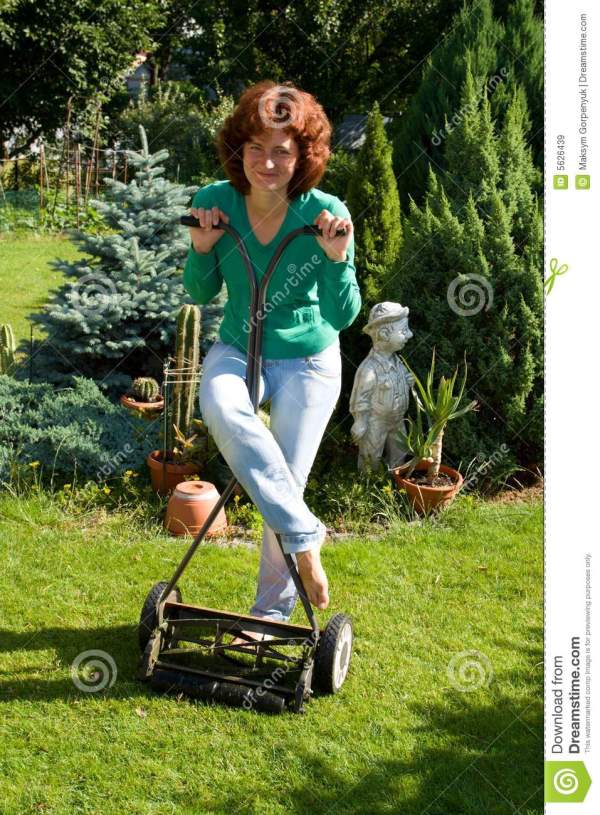 girl with lawn mower stock