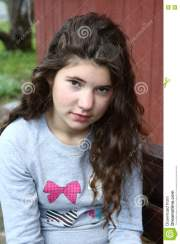 girl with long curly brown hair