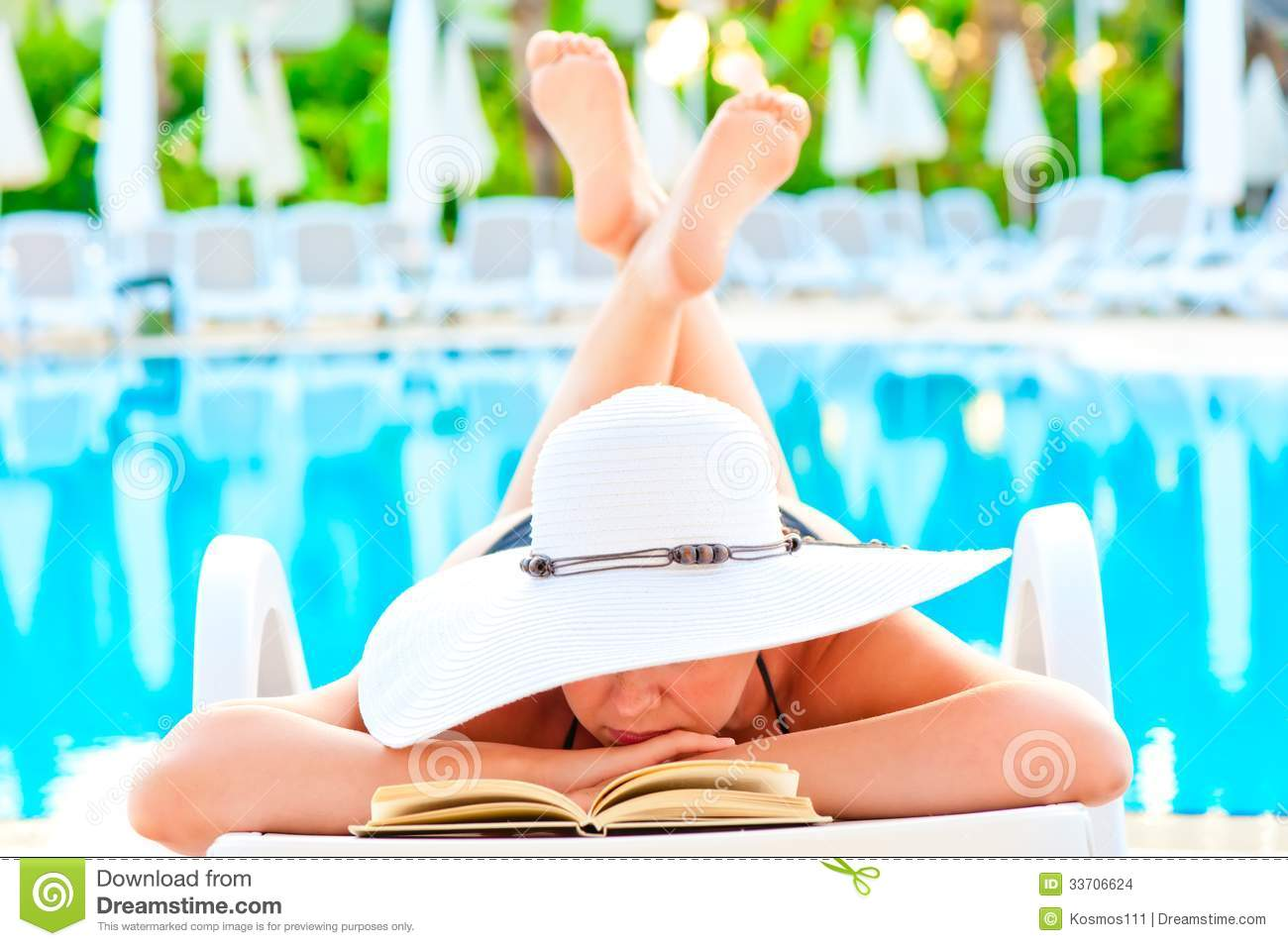 reading poolside lounge chair spandex cover rental girl in a near the pool and romance