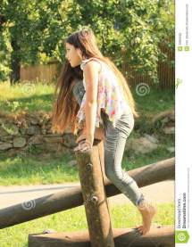 Girl Barefoot On Wooden Construction