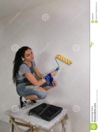 Girl Painting A Wall In Her House Royalty Free Stock
