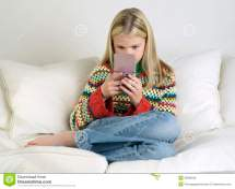 Girl Playing Handheld Video Game Sofa Stock