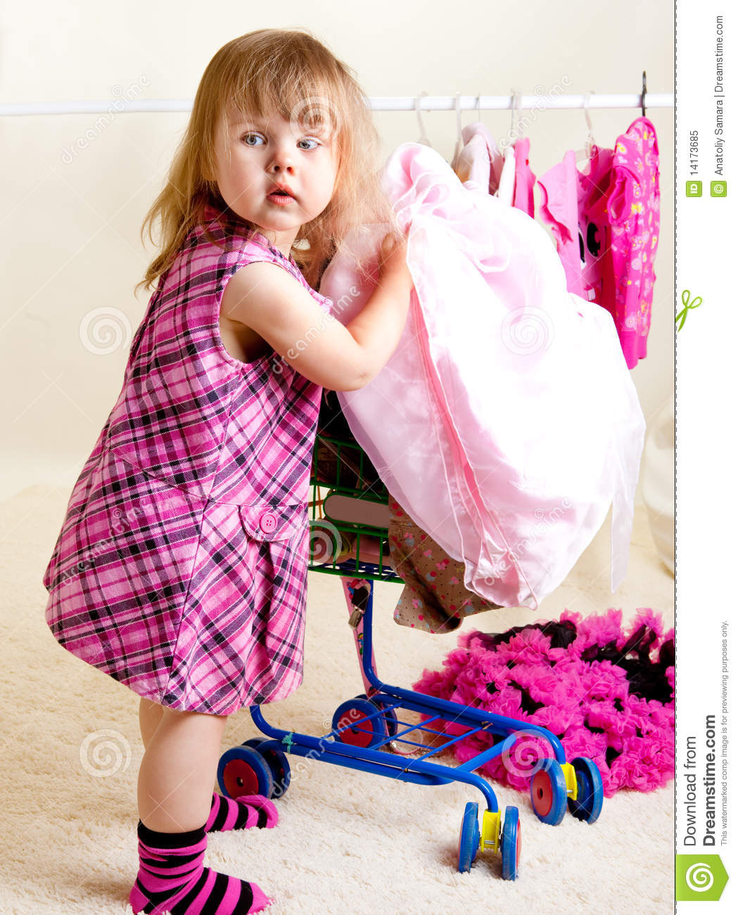 Girl Putting Clothing Into Trolley Royalty Free Stock