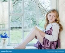 Girl Reading Barefoot