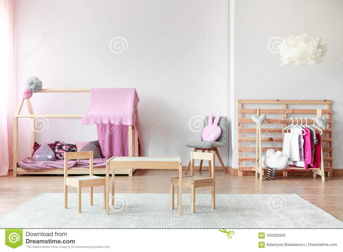 bedroom chair for clothes floating chairs pool girl s in spacious stock image of child on rack with wooden at table and handmade bed