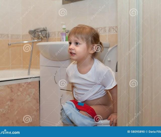 Girl Sitting On Toilet
