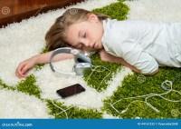 Girl Sleeping On The Carpet . Stock Photo - Image: 44161232