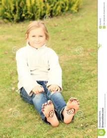 Girl With Smileys Toes And Soles Stock