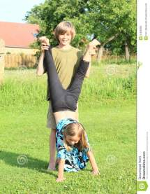 Girl Training Handstand Stock Of Barefooted