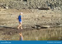Girl Walking Barefoot in Mud