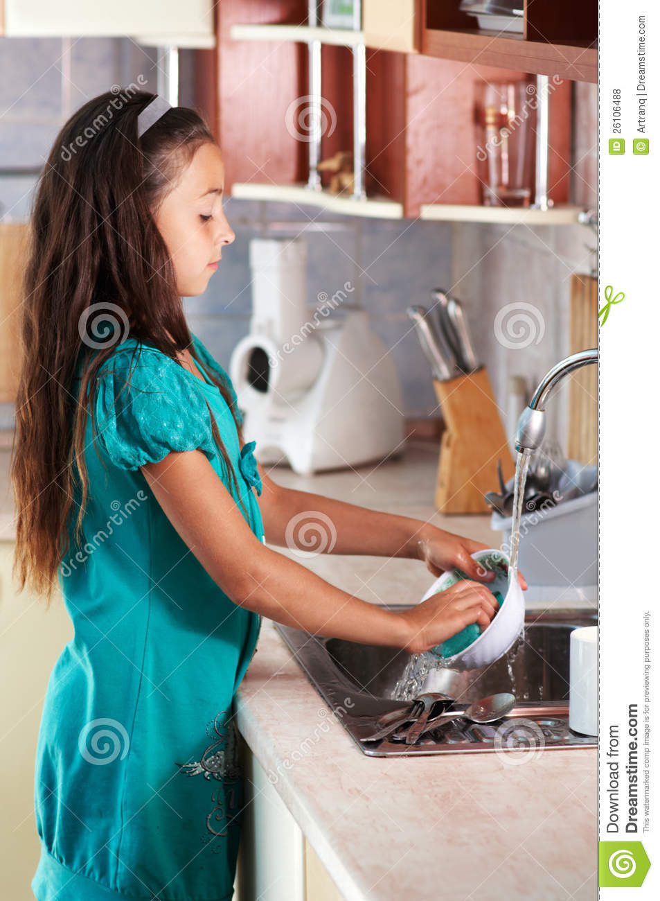 Girl Washing Dishes In The Kitchen Royalty Free Stock