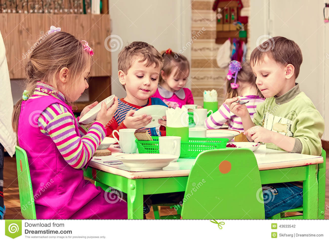 Girls And Boys Eat At The Table Stock Photo Image Of