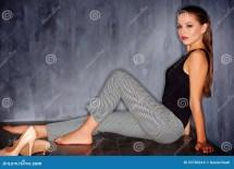 Barefoot Woman Sitting On Floor