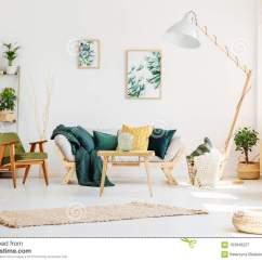 Living Room Pouf Purple Black And Silver Ideas Green With Stock Image Of Furniture Glass Vase On Wooden Table In Front Sofa Gold Pillows