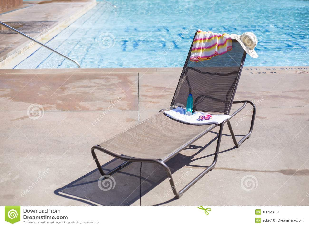 Lounge Chair Towels Lounge Chair By A Swimming Pool With Sunscreen And A Towel Stock