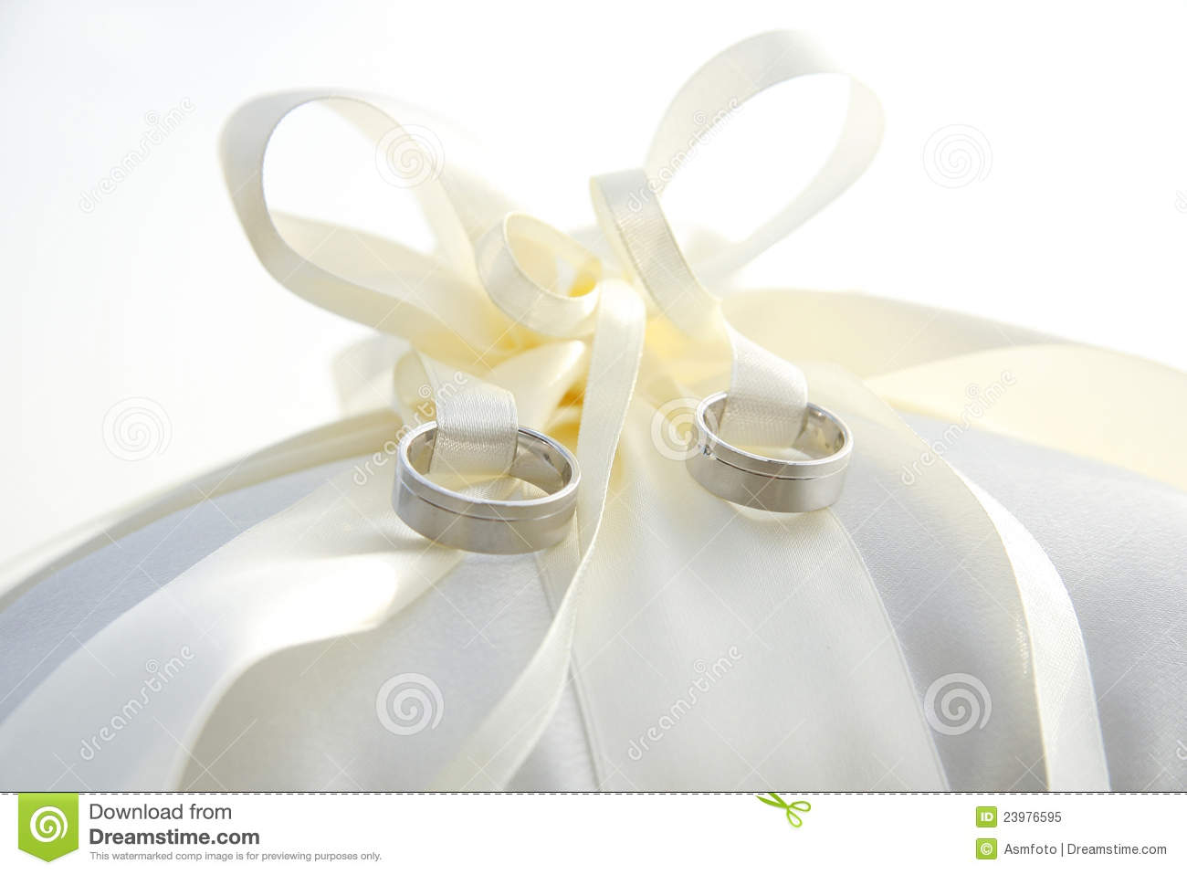 Golden Wedding Rings Laying On Ring Pillow Stock Image