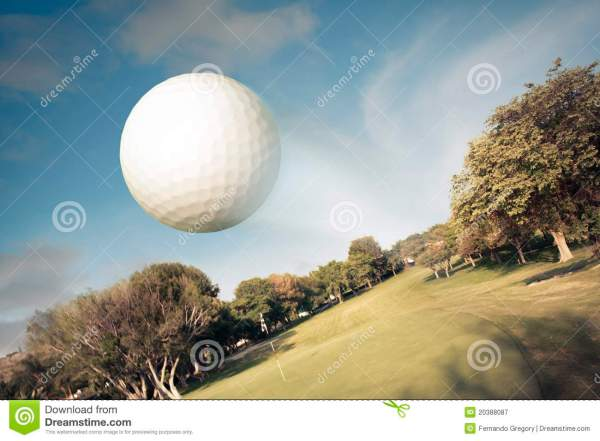 Golf Ball Flying Over Field Royalty Free Stock