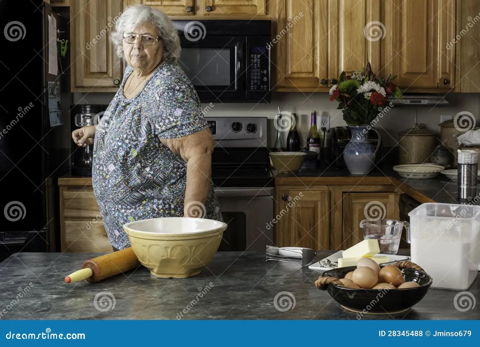 Grandma In A Kitchen Preparing To Bake Stock Photo  Image