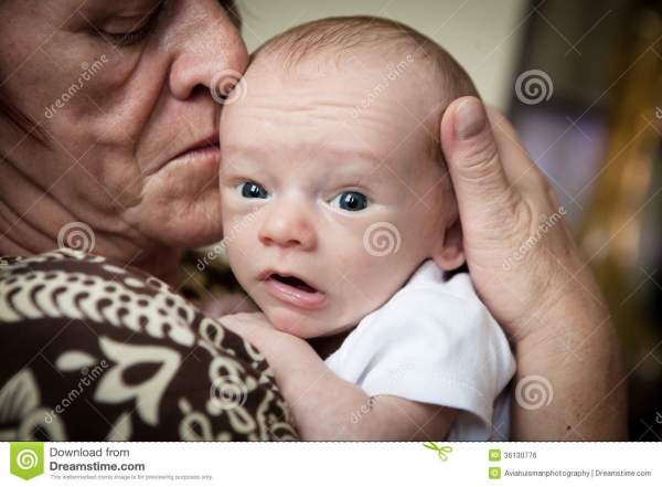 Grandmother Holding Baby Royalty Free Stock