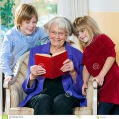 Toddler Reading Chair Childrens Wooden With Rush Seat Grandmother Book To Grand Children Stock Photo