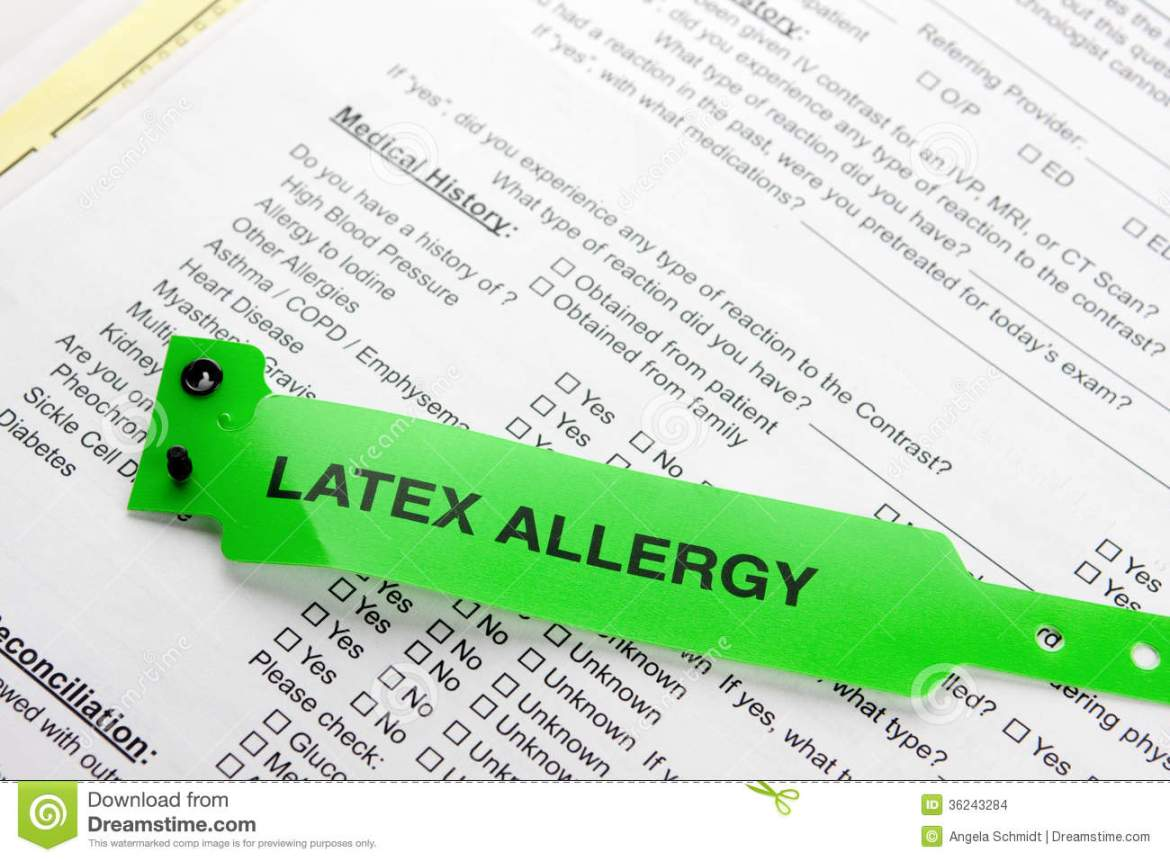 latex allergy patient bracelet on top of a hospital questionnaire ...