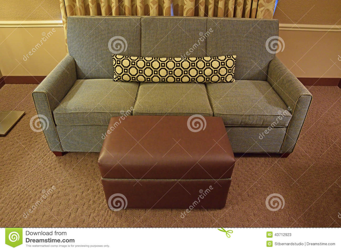 Grey Fabric Sofa With Brown Leather Ottoman And Long Narrow