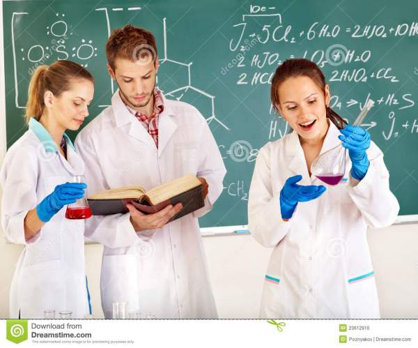 Group Chemistry Student With Flask. Stock