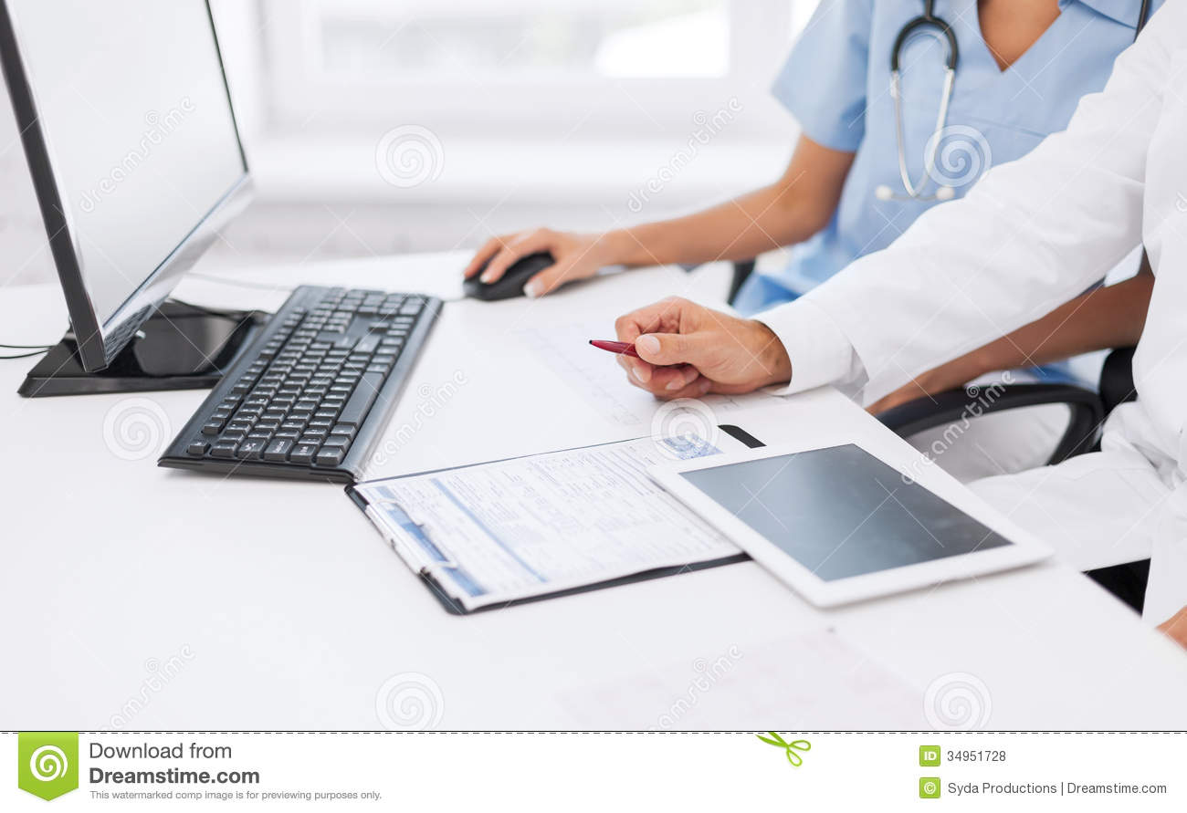 Group Of Doctors Looking At Tablet Pc Royalty Free Stock