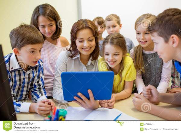 Group Of Kids With Teacher And Tablet Pc School Stock