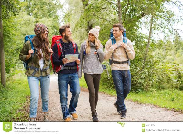 Group of People Walking Outdoors