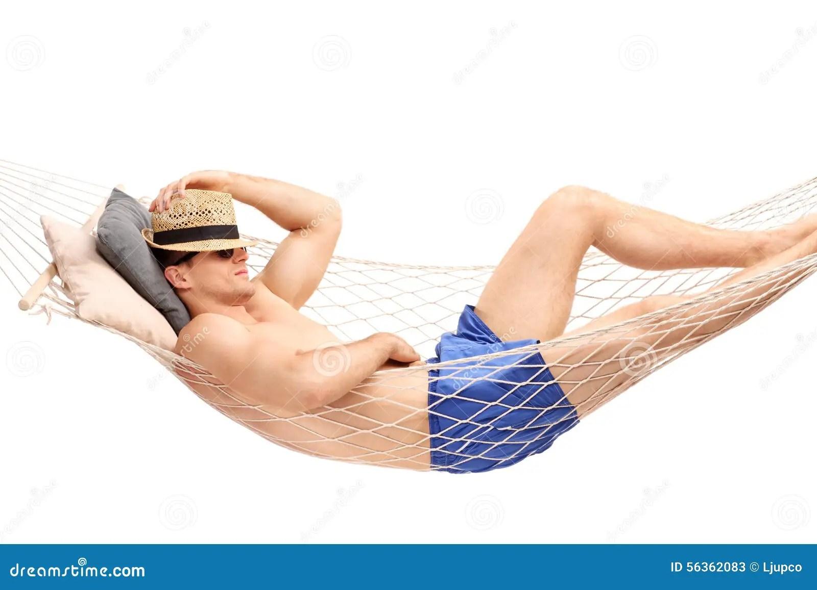 Guy In Blue Swim Trunks Sleeping In A Hammock Stock Photo