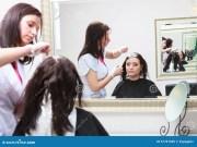 hairdresser applying color female