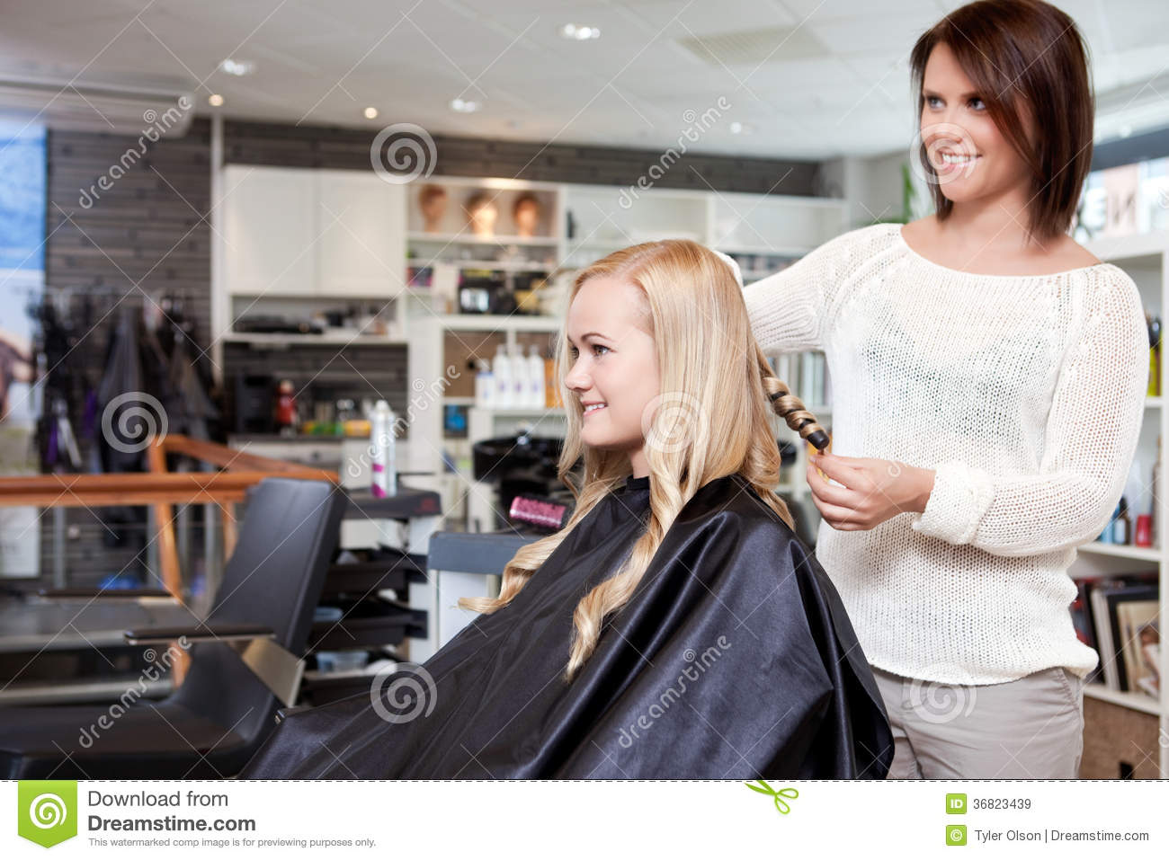 Hairdresser Curling Customers Hair Royalty Free Stock