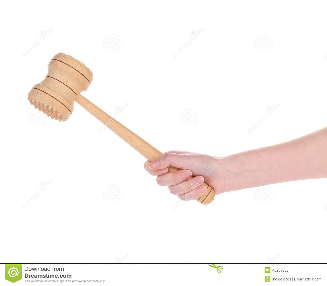 hand holds wooden meat