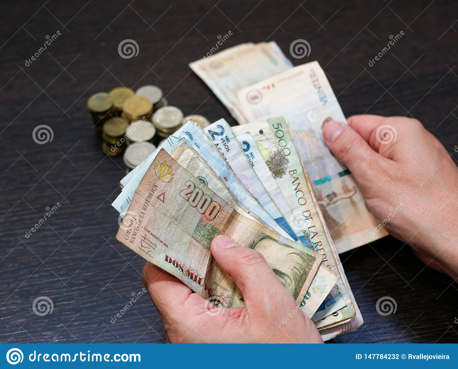 Hands Of A Man Counting Money Colombian Pesos Currency
