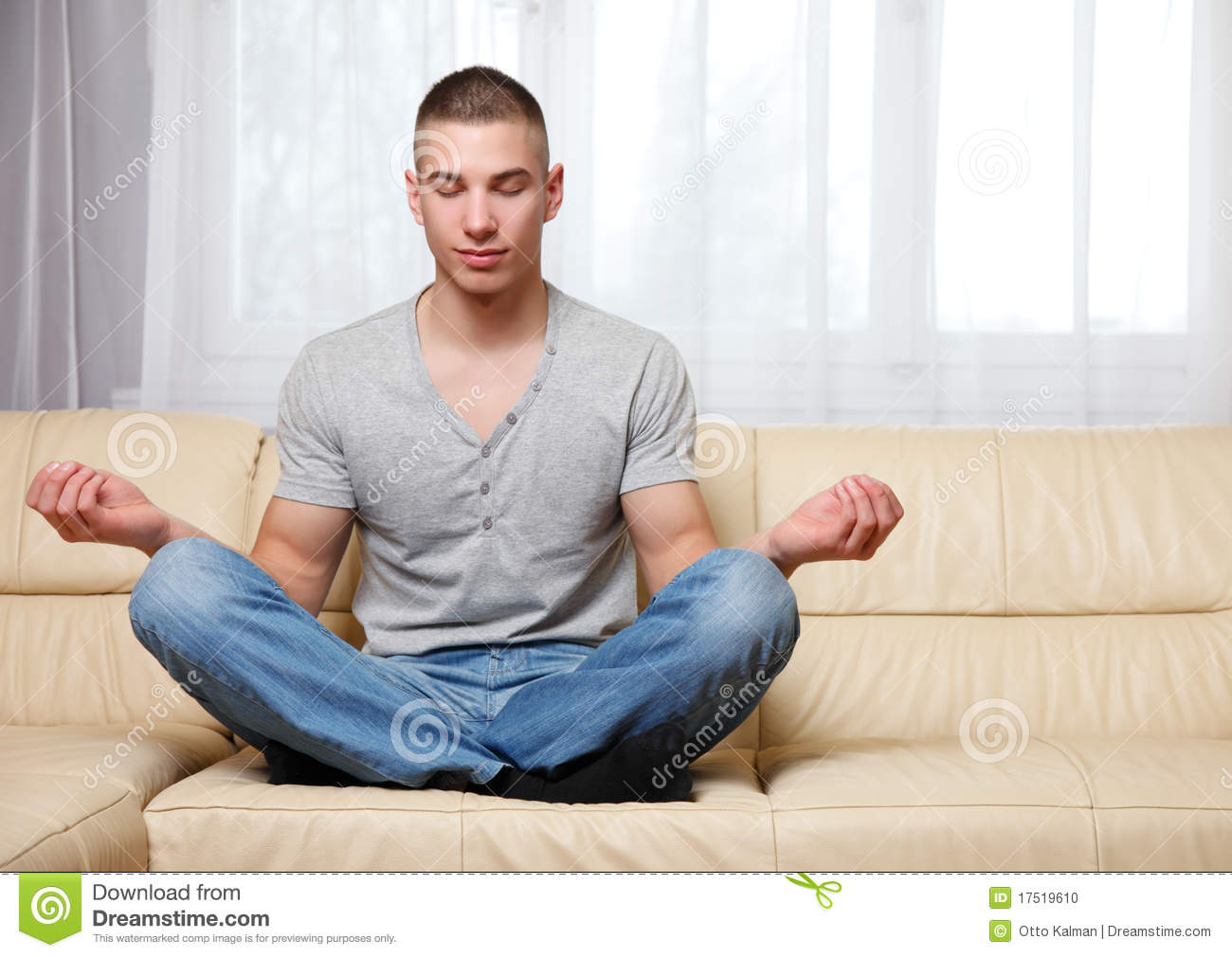 yoga sofa burgundy and loveseat handsome man making on the stock photo image