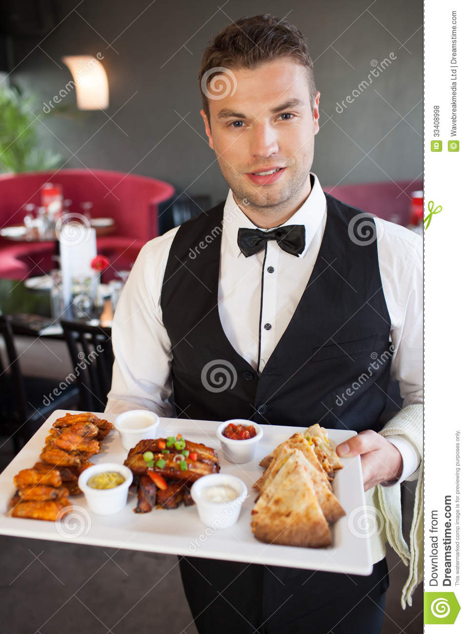 Handsome Waiter Serving Appetizing Finger Food Platter