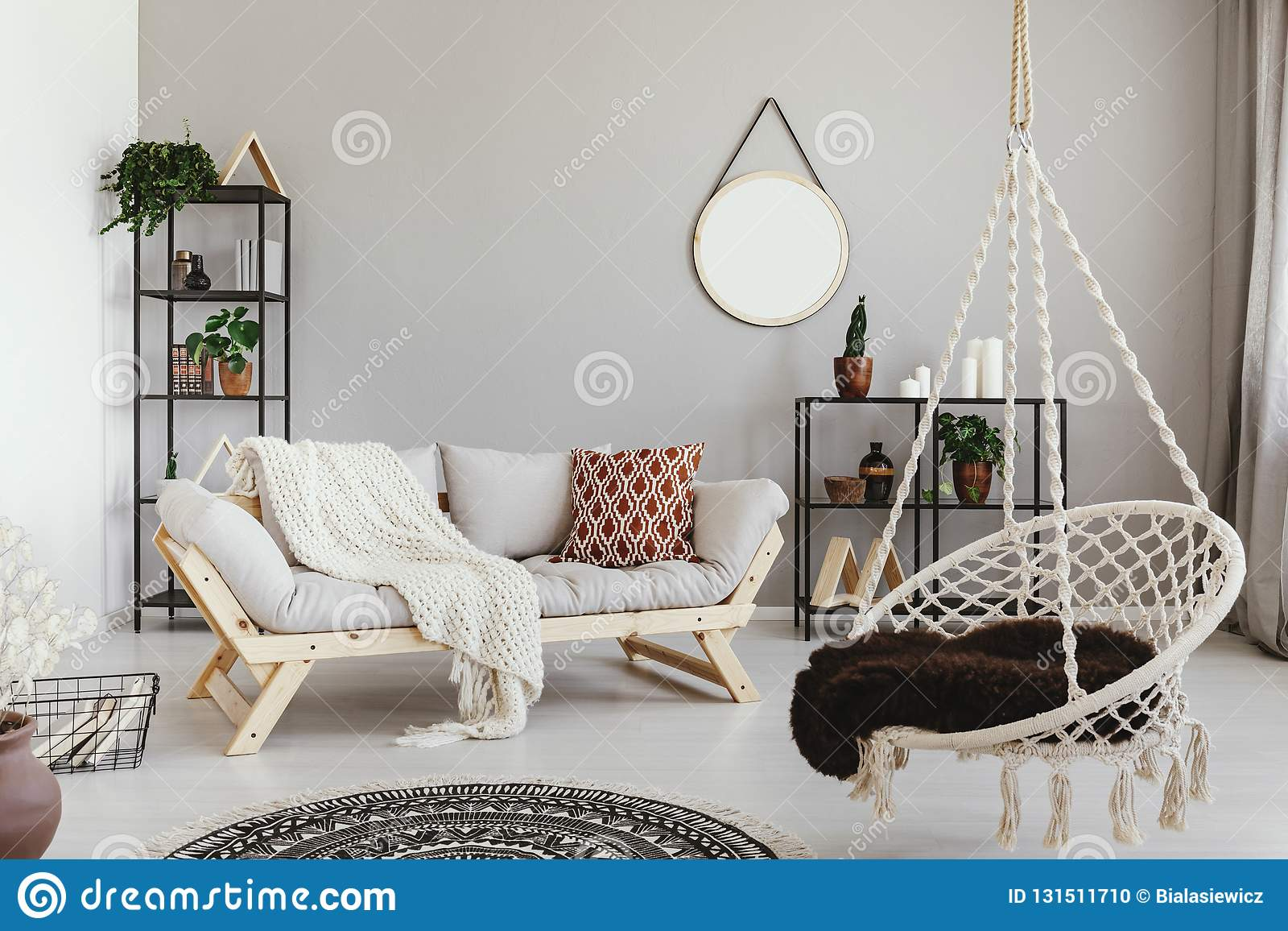 hanging chair in living room folding song and sofa ethno interior with round mirror real photo